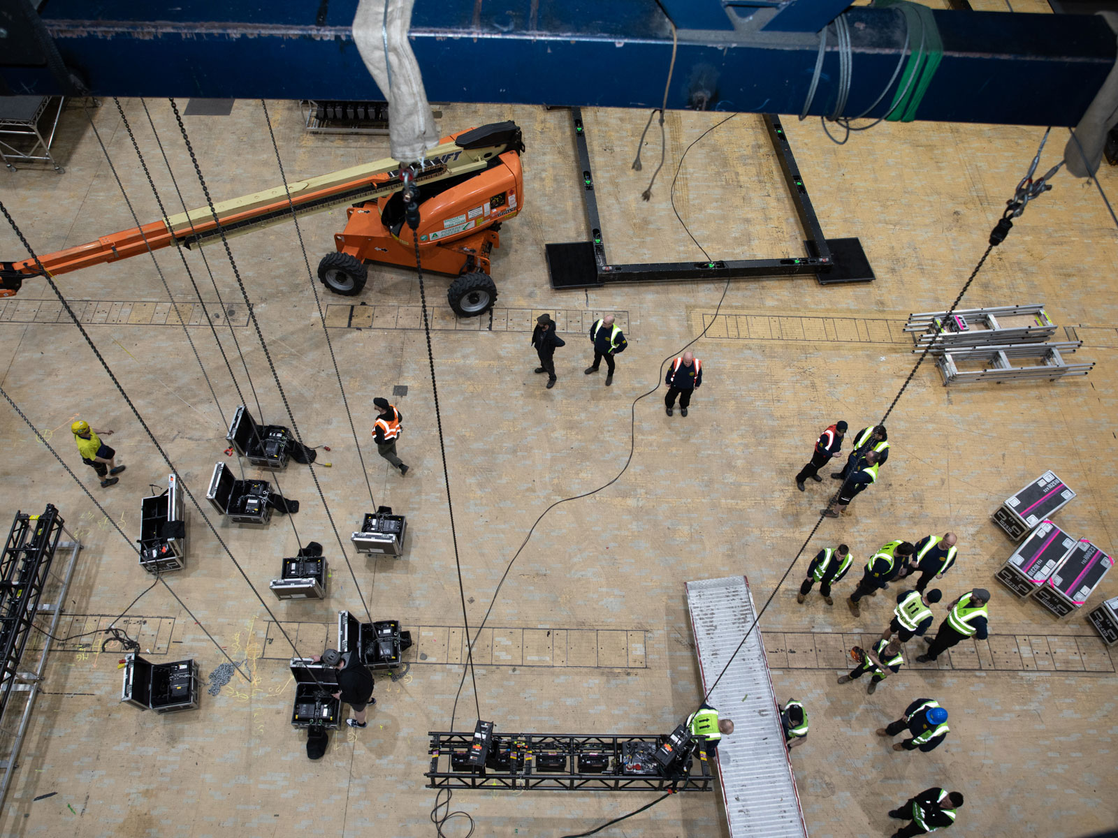 Riggers at work on The 1975 UK Tour, Motorpoint Arena, Cardiff, UK